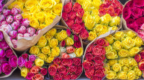 Lot of yellow,pink, red bouquets rose with wrapper in the market. Lot of bouquets rose with wrapper in the market Stock Photo