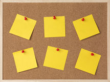 Lot a yellow sticky note on wooden frame cork board.  Royalty Free Stock Photo