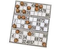 Loteria y pequeño barril sobre blanco Imagen de archivo