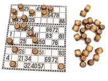 Loteria y pequeño barril sobre blanco Imágenes de archivo libres de regalías
