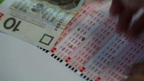 Loterijkaartje stock videobeelden