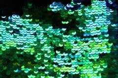 Lotes brilhantes bonitos do fundo da textura de lantejoulas coloridas em g imagens de stock royalty free