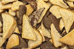 Lotes das partes de textura do close-up do pão do trigo e de centeio fotografia de stock