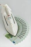 Lotes de cem euro- contas e ferros Imagens de Stock Royalty Free