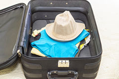 Сlothes for vacation in suitcase Royalty Free Stock Photography