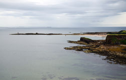 Lothian Coast with Lighthouse. Seacoast in Lothian - region in south Scotland Royalty Free Stock Image