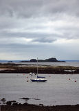 Lothian Coast with Sailing Boat. Seacoast in Lothian - region in south Scotland Royalty Free Stock Photos
