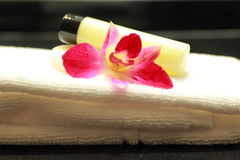 Lotion. Towel and pink ortchid Royalty Free Stock Images