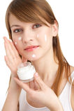 Lotion. Young woman with lotion spots in her face Stock Photography