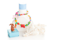 Lotion bottle with seashells Royalty Free Stock Photos
