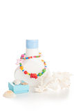 Lotion bottle with seashells Stock Images