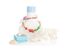 Lotion bottle with seashells Stock Photography