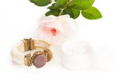 Lotion and bracelet Stock Photo