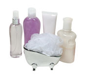 Lotion and Creams with a Scrubber in a Tub Royalty Free Stock Photography