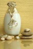 Lotion voor was en steen stock fotografie