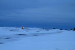 Lotniskowy snowplow po zmierzchu Zdjęcia Stock