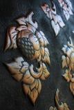 Loto d'ottone. elementi dell'ornamento sulla parete Immagine Stock Libera da Diritti