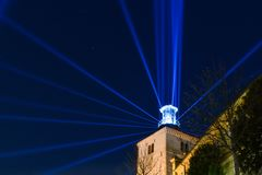 Lotrscak tower in Zagreb, Croatia during festival of lights. Lighthouse with blue light beams in night sky stock images