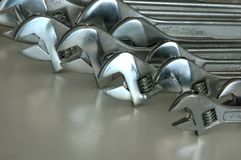 Lots of adjustable wrenches. On light background Royalty Free Stock Image