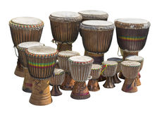 Lots of african drums. Lots of african djembe drums in different sizes in white back stock photos