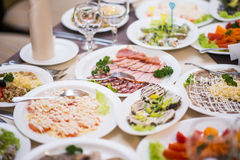 Lots appetizers on a table in a restaurant Royalty Free Stock Images