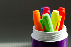 Lots of Assorted Colors Marker Pens. On metal background Royalty Free Stock Images