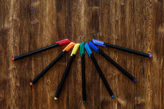 Lots of assorted rainbow colors marker pens, copyspace wooden background Royalty Free Stock Photography