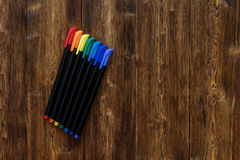 Lots of assorted rainbow colors marker pens, copyspace wooden background Stock Photography