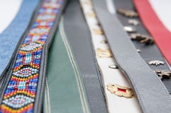 Lots of belts. Lots of leather belts ligned up together Stock Photos