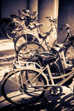 Lots of bicycles. Traditional Italy street scene. Yellow and blue tint Royalty Free Stock Photos