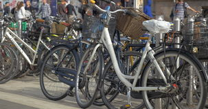 Lots of bicycles parked in the street. COPENHAGEN, DENMARK - SEPTEMBER 10, 2015: Many bicycles parked in the street. Copenhagen is considered to be the cycling stock video footage