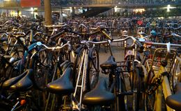 Lots of bicycles parked together in chaos in Holland, in Amsterdam royalty free stock image