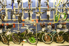 Lots of bikes and helmets for sale in store Stock Photo