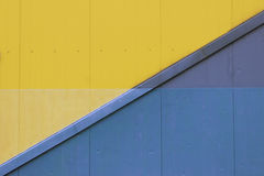 Lots of blue and yellow paint on the wall Royalty Free Stock Images
