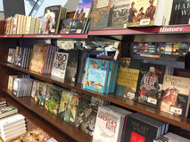 Lots of books on shelves selling at bookshop Stock Images
