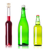 Lots bottles of various alcoholic drinks. Over white background royalty free stock image