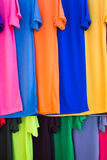 Lots of bright colorful clothing Stock Images