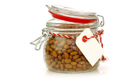 Lots of brown beans in a glass jar Stock Photography