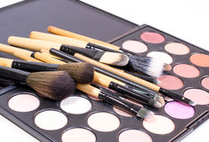 Lots of brushes with creamy eye shadows for make up Royalty Free Stock Image