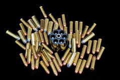 Lots of bullets and revolver loader Royalty Free Stock Image