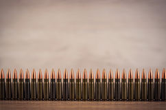 Lots of bullets on a wooden background Royalty Free Stock Photos