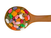Spoon of jelly beans isolated over white background Royalty Free Stock Images
