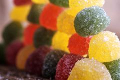 Lots of candies are laid out in the wall, a number of marmalade candies of different colors, perspective of candies. Lots of candies are laid out in the wall, a Stock Photo