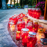 Lots of candles at dusk at cemetery in Dalmatia Stock Images