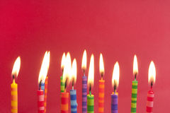 Lots of candles on a red background Royalty Free Stock Photo