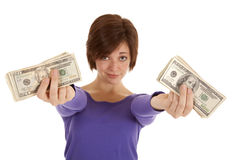 Lots of cash hands. A woman with a serious expression on her face holding out her money in her hands Royalty Free Stock Photo