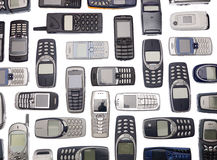 Lots of cellphones. Towards white background Stock Images