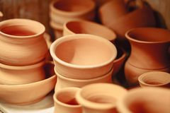 Lots of ceramic pots and jugs on the table. royalty free stock images