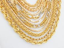 Lots of chains. Lots of designed gold chains Royalty Free Stock Photo