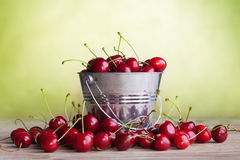 Lots of cherries on old table